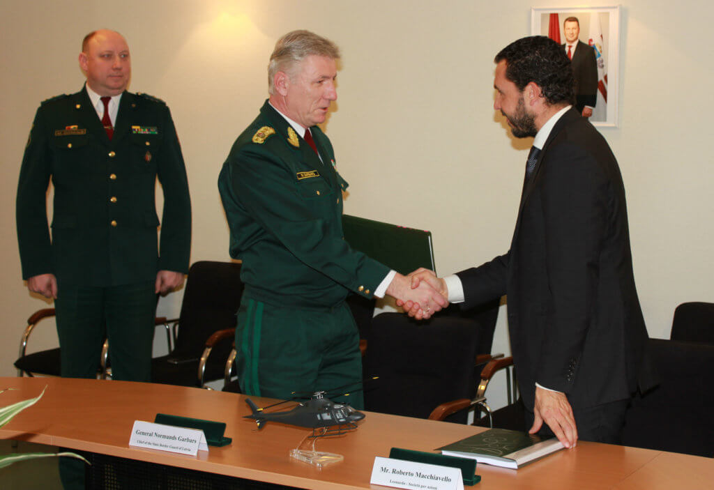 Gen. Normunds Garbars, chief of the State Border Guard of Latvia, shakes hands with Roberto Macchiavello from Leonardo Corporation in recognition of the new AW119Kx contract. Leonardo Photo