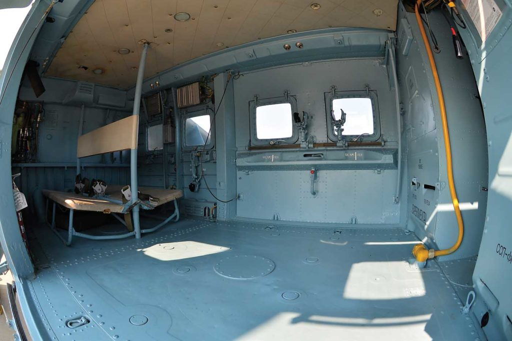 In the cabin, six window/gun ports allow small arms to be fired from swivel mounts, which are elevation- and azimuth-limited due to the presence of the main rotor and wings. Skip Robinson Photo