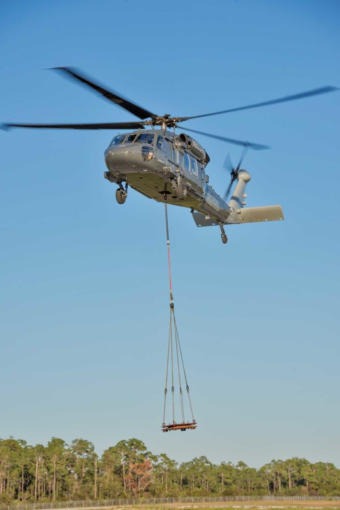 The S-70i retains the A model's 9,000-pound capacity cargo hook, but improves hover-out-of-ground-effect performance over the A by 850 pounds at 6,000 feet pressure altitude and 30 C (86 F). Sikorsky Photo