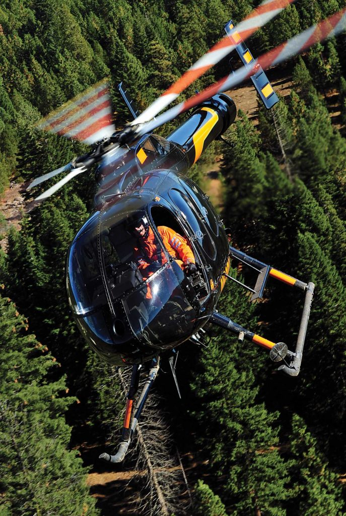 A Brim MD 600N flies above vast forest in Oregon. The company has a training site near Ashland that is utilized quite often. Skip Robinson Photo
