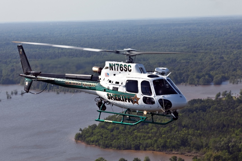 A Seminole Co. (Florida) Sheriff's Office Airbus H125 flies over water.