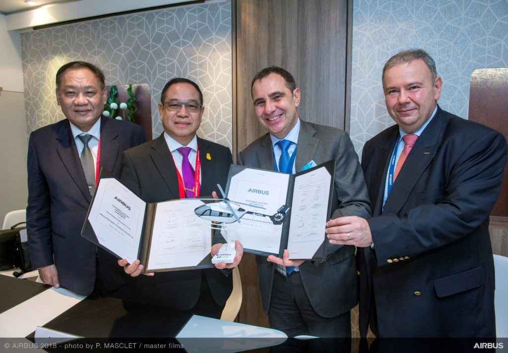Thai Aviation Industries and Airbus Helicopters executives celebrate the agreement which will heighten the technical competency of helicopter maintenance in Thailand. Philippe Masclet Photo