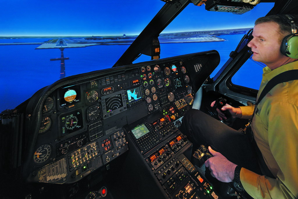 Students practice with instruction inside a FlightSafety Sikorsky S-76B Flight Simulator. FlightSafety Photo
