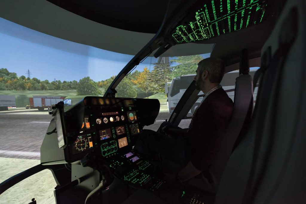 The author during a demonstration of a HEMS training sortie in the EC135 simulator. Lloyd Horgan Photo