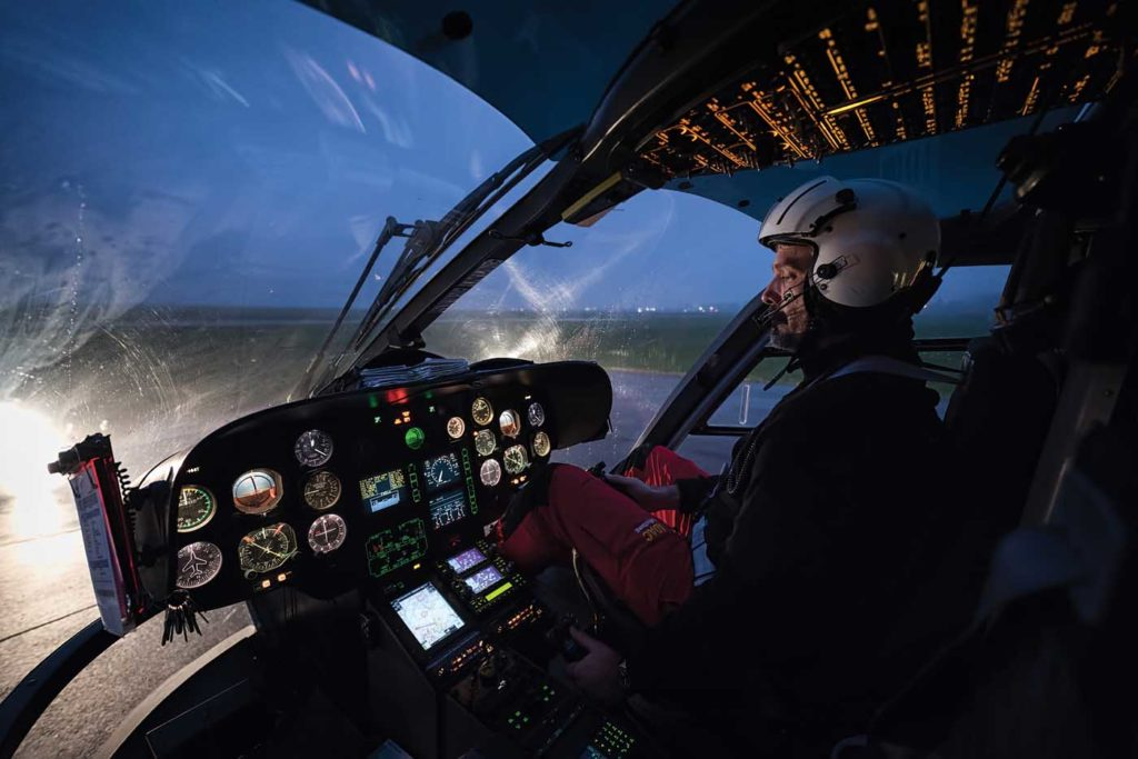 Pilot and base manager Michael Schneider sits in the cockpit of an EC135 at the Aachen rescue station. Lloyd Horgan Photo
