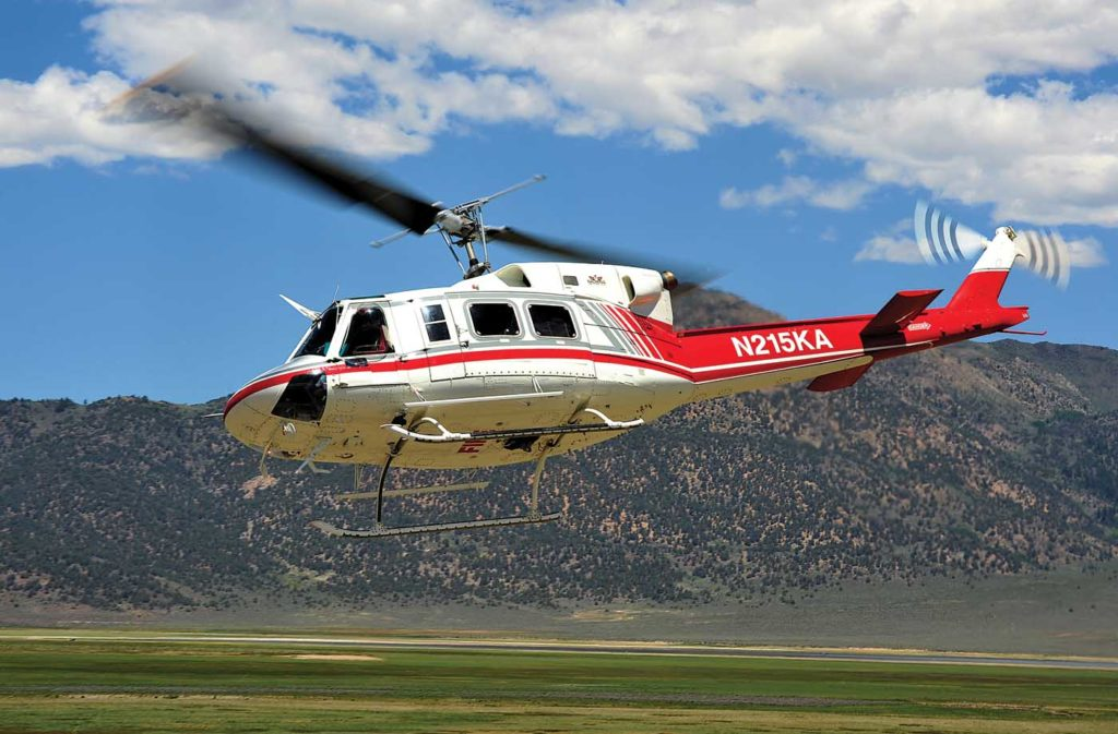 The Bell 412 is replacing the Bell 212 (pictured) in some utility roles. Skip Robinson Photo