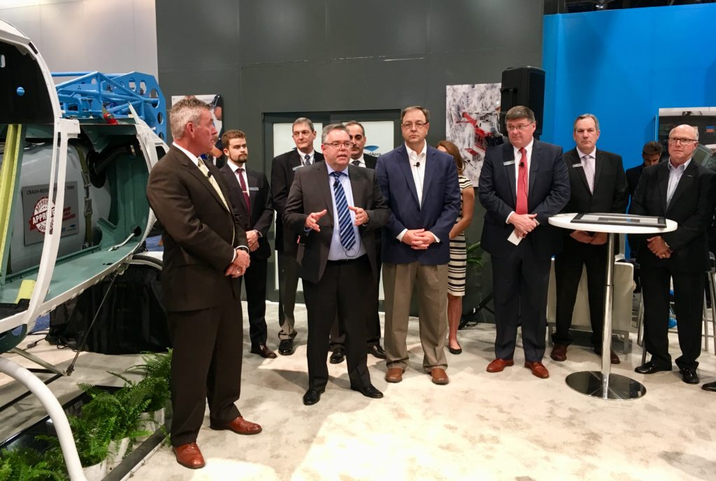 Ceremony at StandardAero booth at Heli-Expo