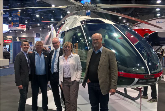 Kopter and Safomar Aviation executives celebrate the latter's order for two SH09s at HAI Heli-Expo 2018. Kopter Photo