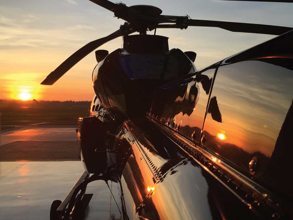 An Airbus AS355 TwinStar sits on the ramp as the sun sets. The ebb and flow of demand for vertical flight drives the international helicopter brokerage industry. Airbus Helicopters Photo