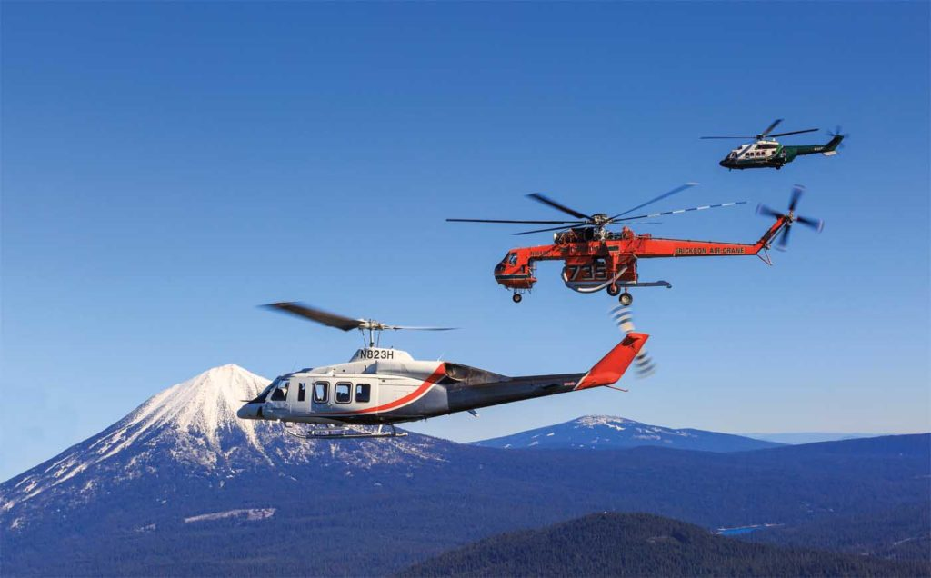 A unique company with a unique fleet. An Erickson S-64E Aircrane (center) is flanked by the two other mainstays of Erickson Inc.'s fleet - a Bell 214ST (foreground) and an Airbus AS332L1 Super Puma (background). Heath Moffatt Photo