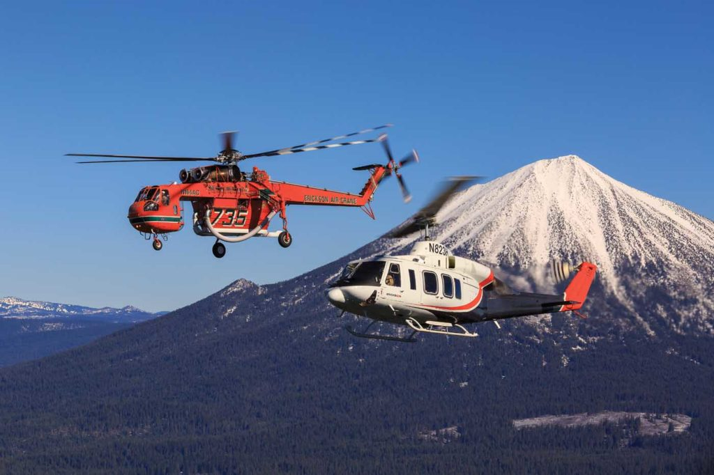An S-64 Aircrane and Bell 214ST hold a hover in front of Mount McLoughlin near Medford, Oregon. Heath Moffatt Photo