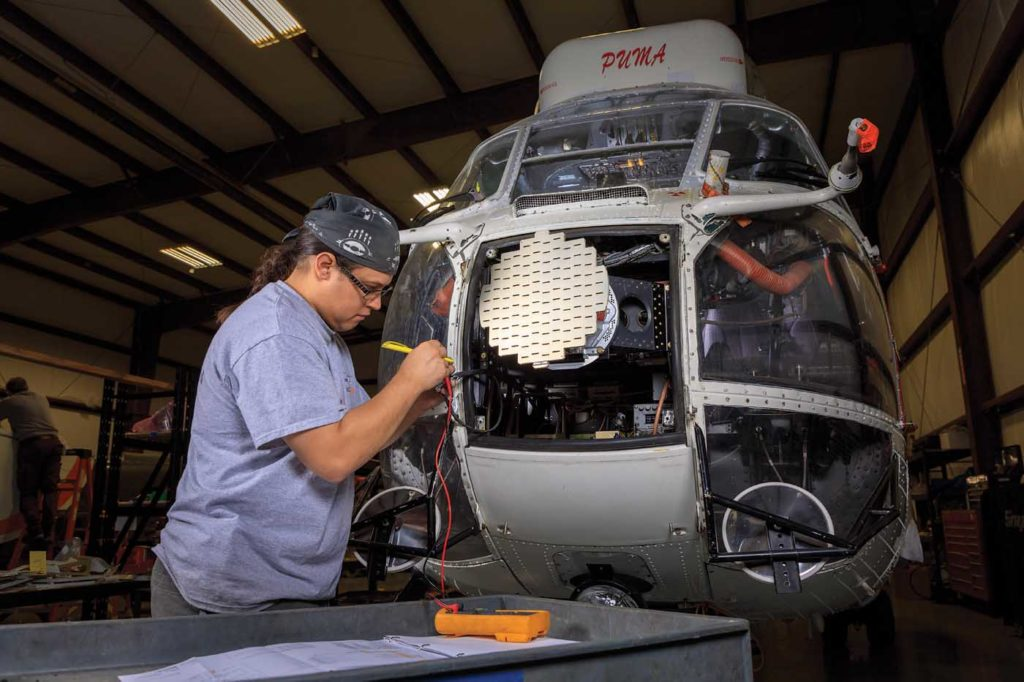 Avionics/airframe maintenance engineer Mingan Kijika conducts a wiring test on an Airbus AS330 Puma. Heath Moffatt Photo