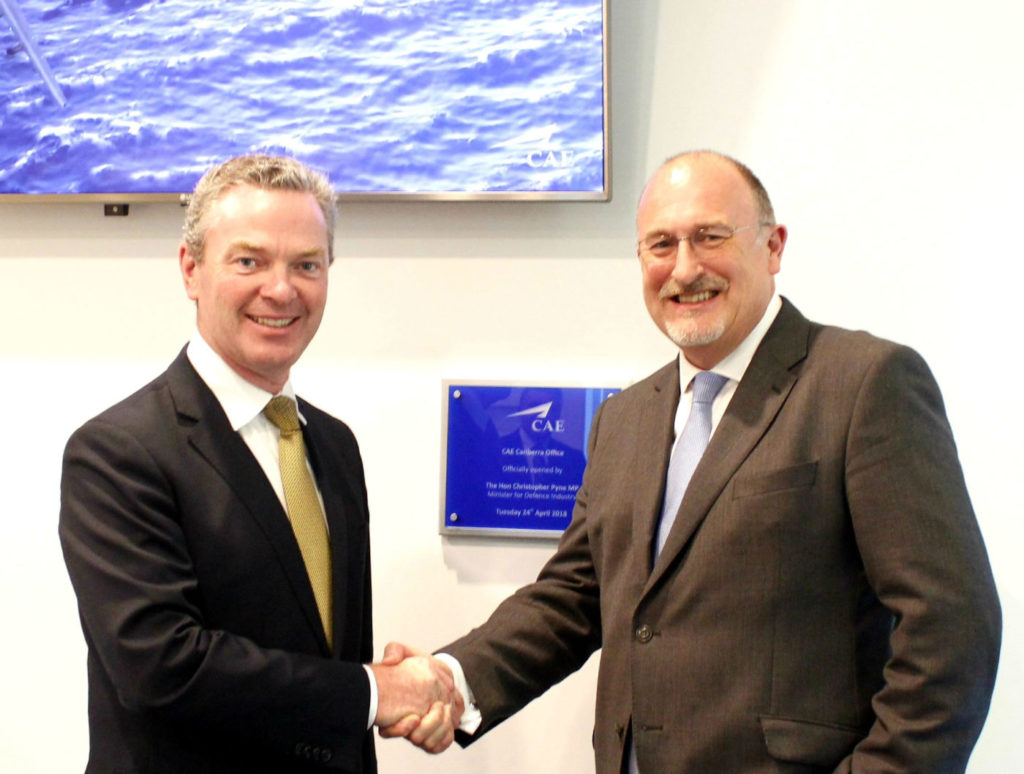 Australia's Minister for Defence Industry the Honorable Christopher Pyne (left) congratulates Ian Bell, CAE's vice president and general manager, Asia-Pacific/Middle East, on the opening of CAE's new office in Canberra. CAE Photo