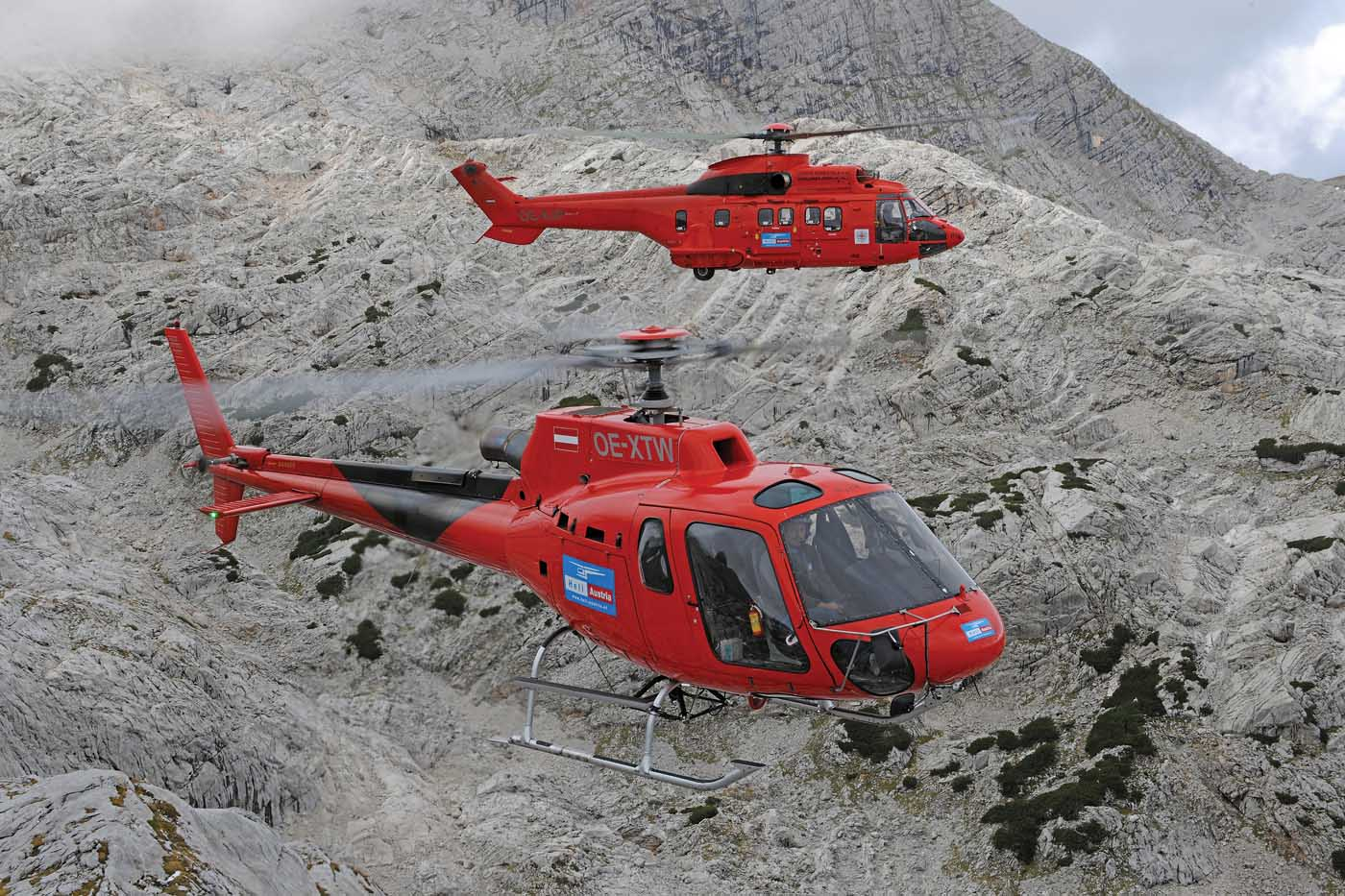 There are over two dozen helicopters in the Heli-Austria fleet, ranging in size from the AS350 AStar (foreground) to the AS332 Super Puma (background). Anthony Pecchi Photo