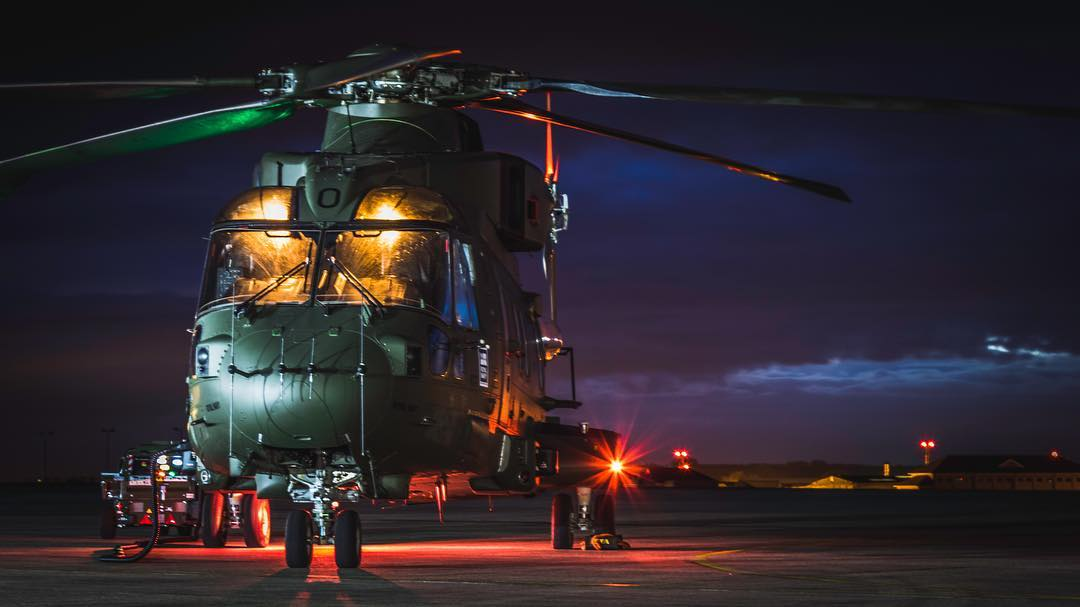 A Royal Navy AW101 Merlin HC3 lights up at night. Photo submitted by Instagram user @awol_images using #verticalmag