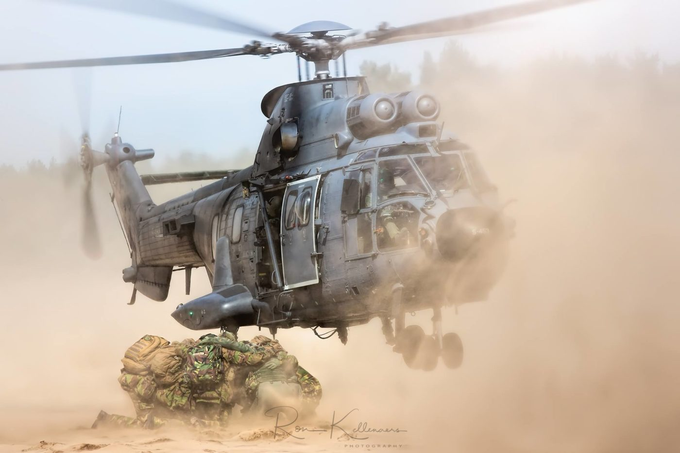 An Aerospatiale AS532 Cougar picks up troops at a military training area in the Netherlands. Photo submitted by Ron Kellenaers