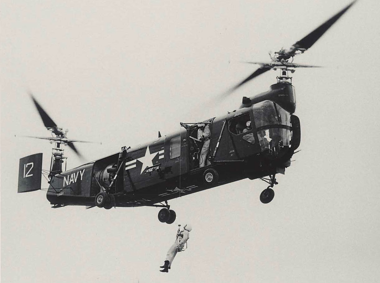 The HSL-1 was the first – and last – tandem-rotor aircraft developed by Bell. Here, ship 12, built in 1954, is flown at Bell's facility to test a hoist. Jeff Evans Collection Photo