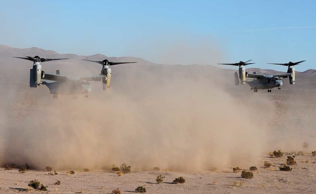 Two MV-22Bs practice a TRAP mission in the California desert. This is a constrained combat rescue of downed aircrews. Skip Robinson Photo