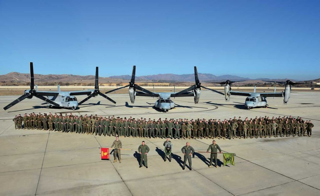 A MV-22B squadron consists of around 210 people; each of them has an important role to play in the unit's operations. Here, the men and women of the VMM-164 Knightriders, who have a long and proud history, stand in front of their aircraft. Skip Robinson Photo