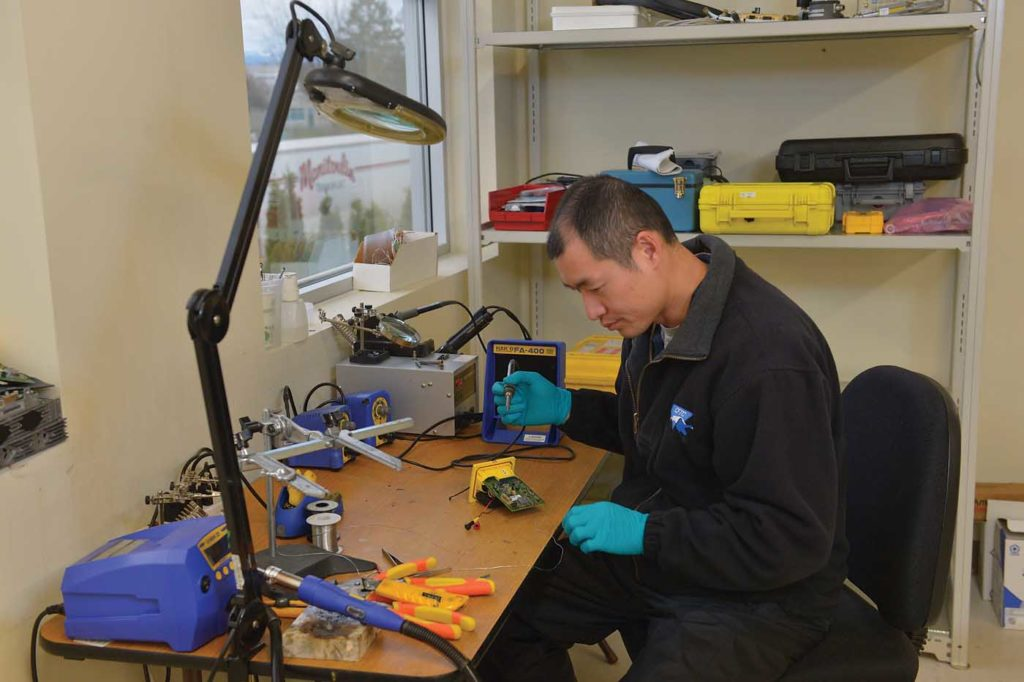 Avionics/bench technician Michael Guo repairs a Kannad emergency location transmitter (ELT). Aeromni Aerospace is the only authorized repair center in Western Canada for Kannad ELTs. Charlie Vowles Photo