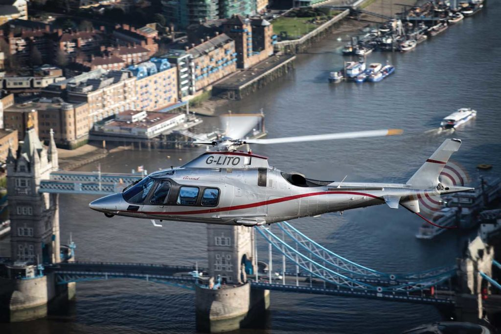 One of Castle Air's A109S Grand models flies past the iconic Tower Bridge in London. Lloyd Horgan Photo