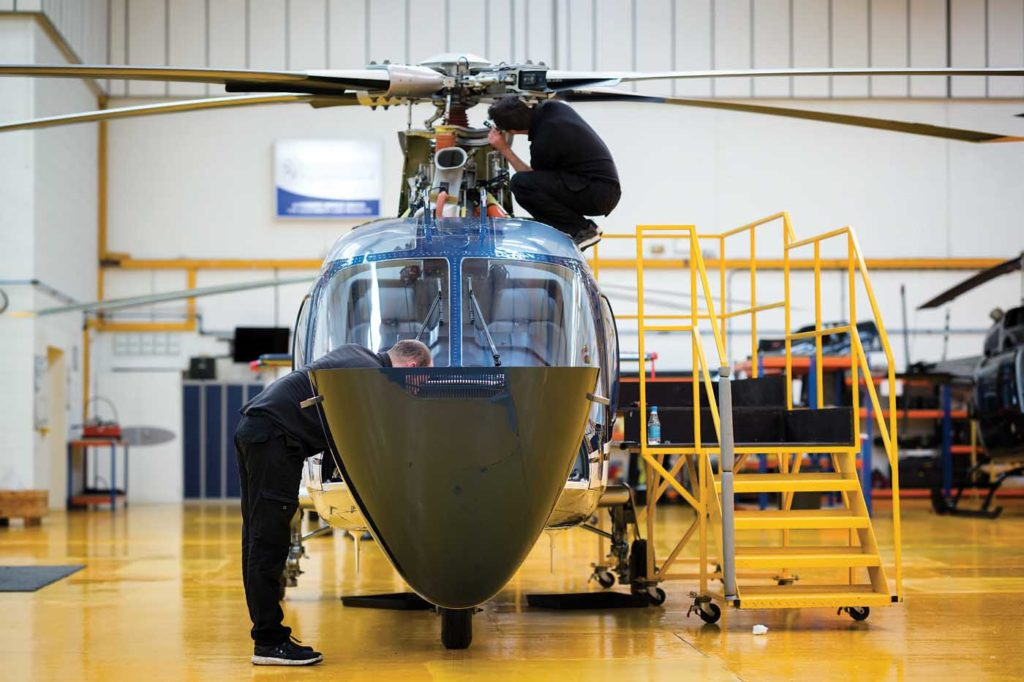 Engineers work on an A109 at Castle Air's Biggin Hill facility. Lloyd Horgan Photo