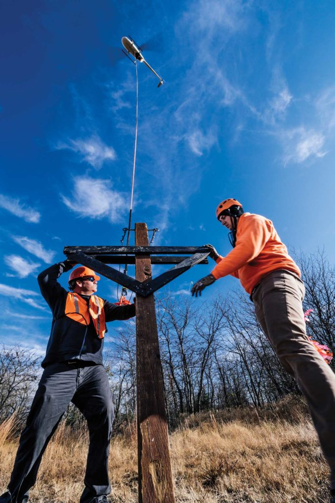 Setting this replica power pole is one of the final exercises of the course. Will Graham Photo