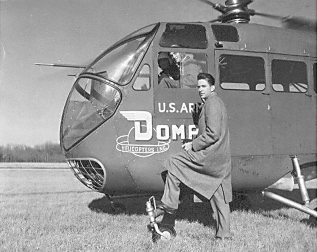 Glidden Doman next to a Doman LZ-5 helicopter in the early 1950s. Doman Helicopters Photo