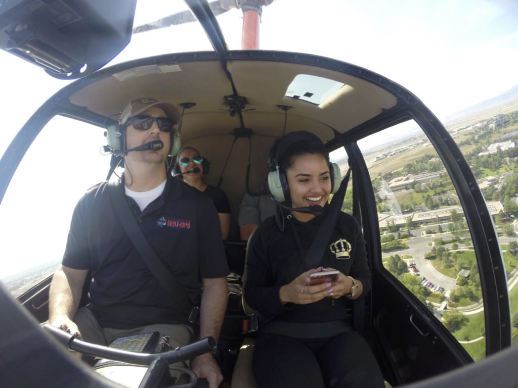 A pilot and passengers during a tour in a Robinson helicopter