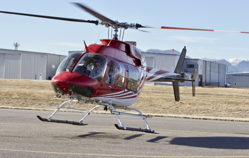 An Aero Tech Bell 407 helicopter lifts off the ground