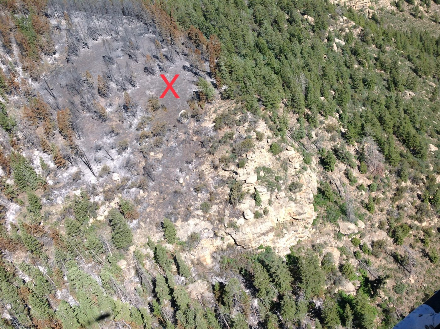 The rugged mountainous terrain from which the firefighter was evacuated
