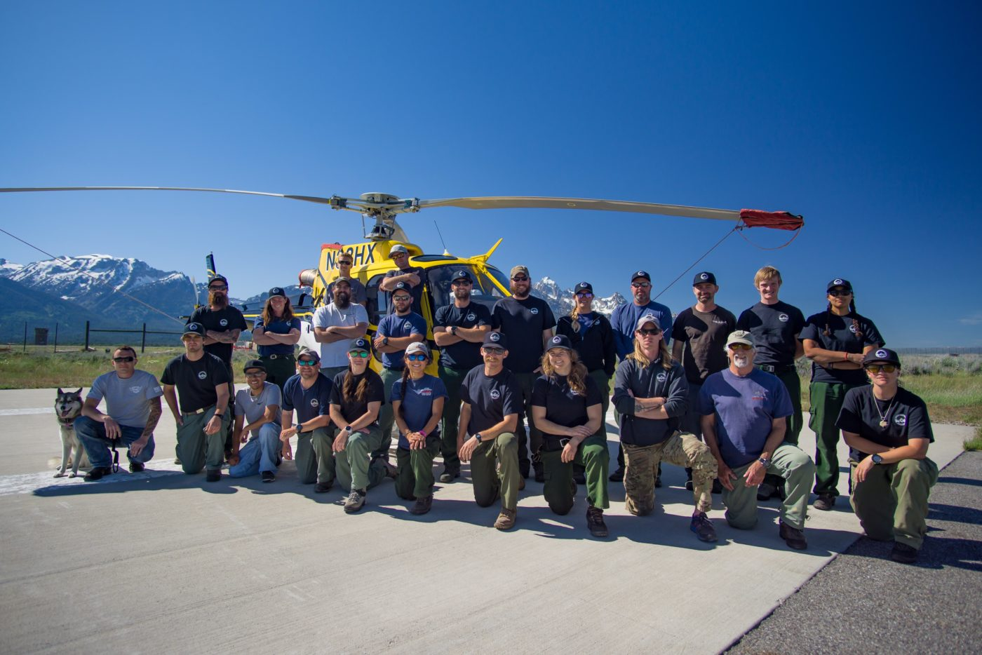 Group photo of the Teton helitack crew with a helicopter