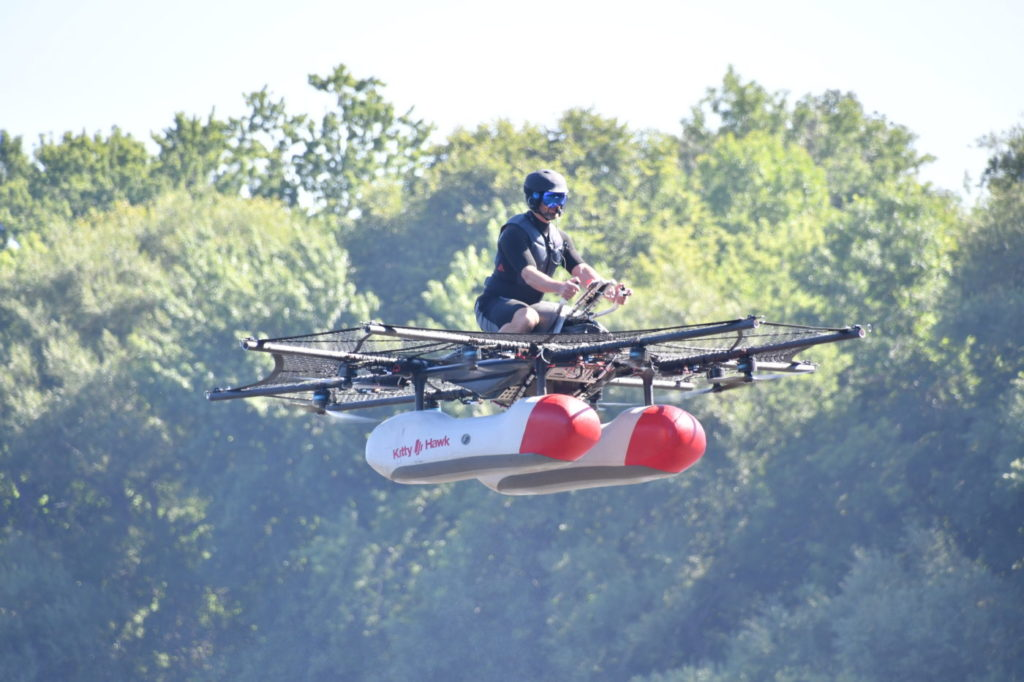 When publicly debuted at EAA AirVenture OshKosh in July 2017, the prototype featured a motorcycle (or personal watercraft) style seat and handlebars, a pair of floats and eight electric-powered propellers covered by protective netting. Ken Swartz Photo