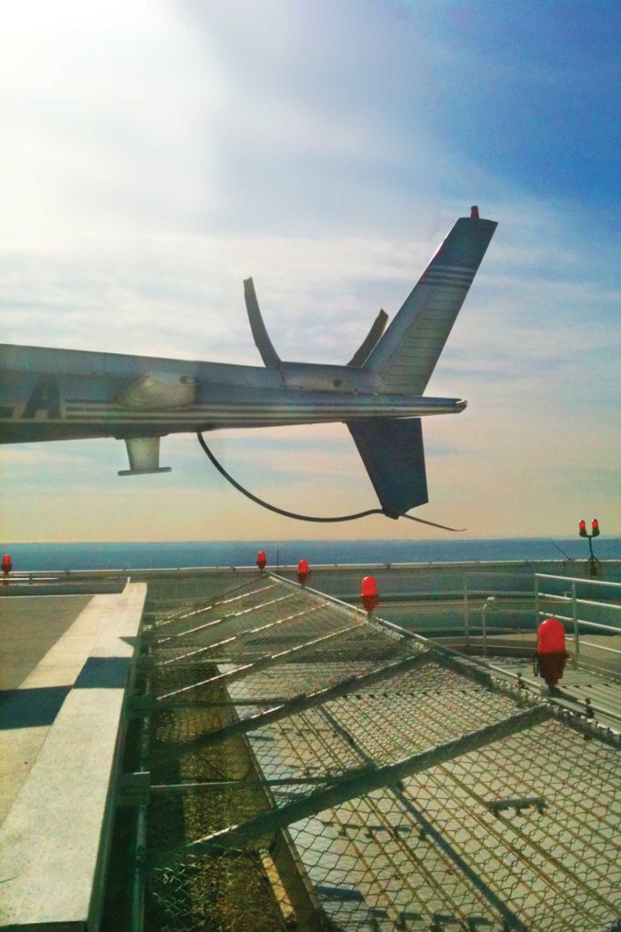 During their recon of the AON rooftop helipad, the authors realized that the elevated netting and lights posed the risk of a tail strike if pilots came in too fast. Photo courtesy of Jack Schonely.
