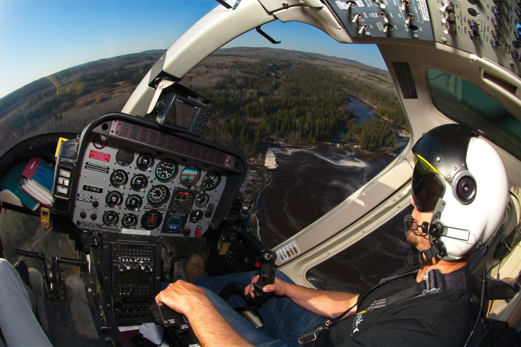 Longtime Wisk Air pilot Brock Yaskovitch flies one of the company's 407s over the Kaministiquia River near Thunder Bay. Yaskovitch said the region sees weather typical of coastal locations due to the sheer size of Lake Superior, with major fog banks and storms. Mike Reyno Photo
