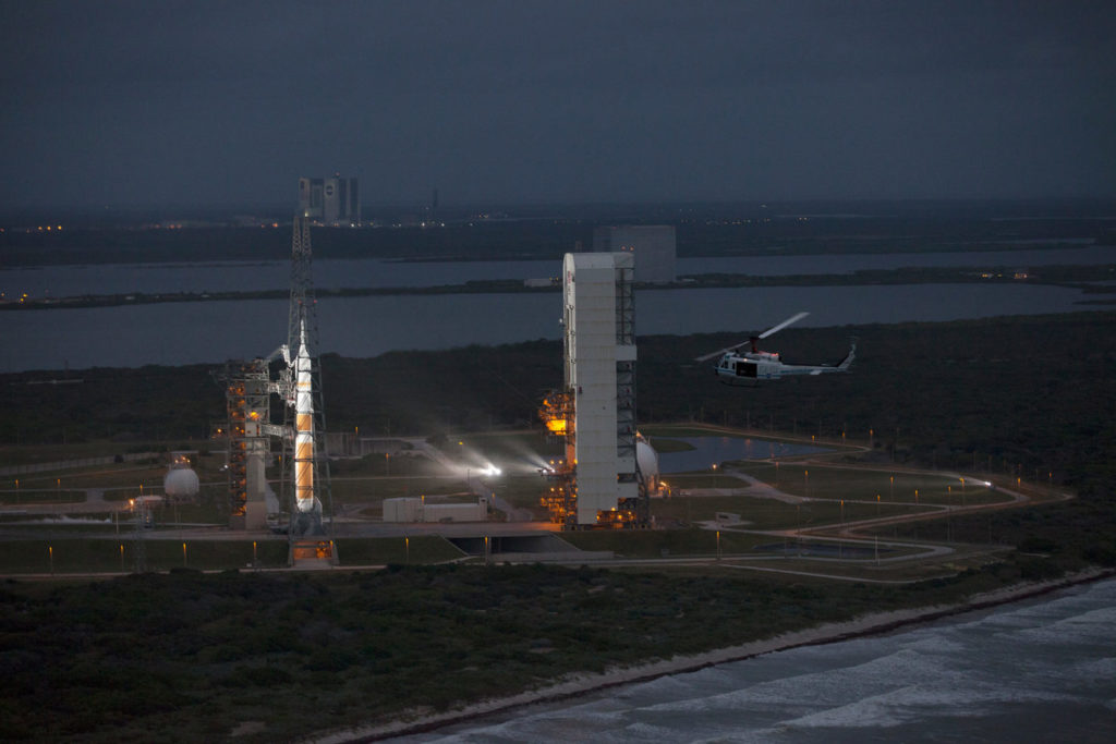This helicopter view of Space Launch Complex 37 at Cape Canaveral Air Force Station in Florida shows the United Launch Alliance Delta IV Heavy rocket as it stands ready to boost NASA's Orion spacecraft on a 4.5-hour mission on Dec. 4, 2014. The liftoff was postponed because of an issue related to fill and drain valves on the Delta IV Heavy rocket that teams could not troubleshoot by the time the launch window expired. NASA/Kim Shiflett Photo
