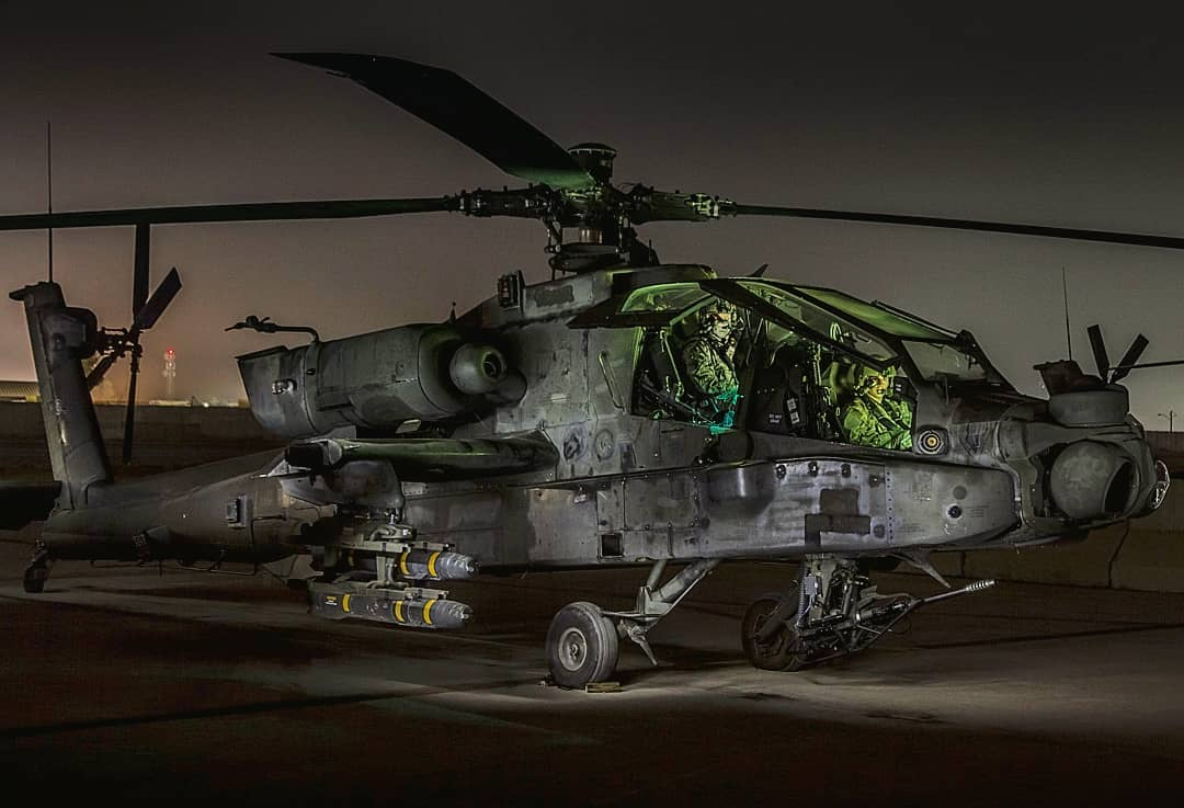 A night shift crew does a pre-mission runup before taking off in a Boeing Apache AH-64. Photo submitted by Instagram user @combataviator using #verticalmag