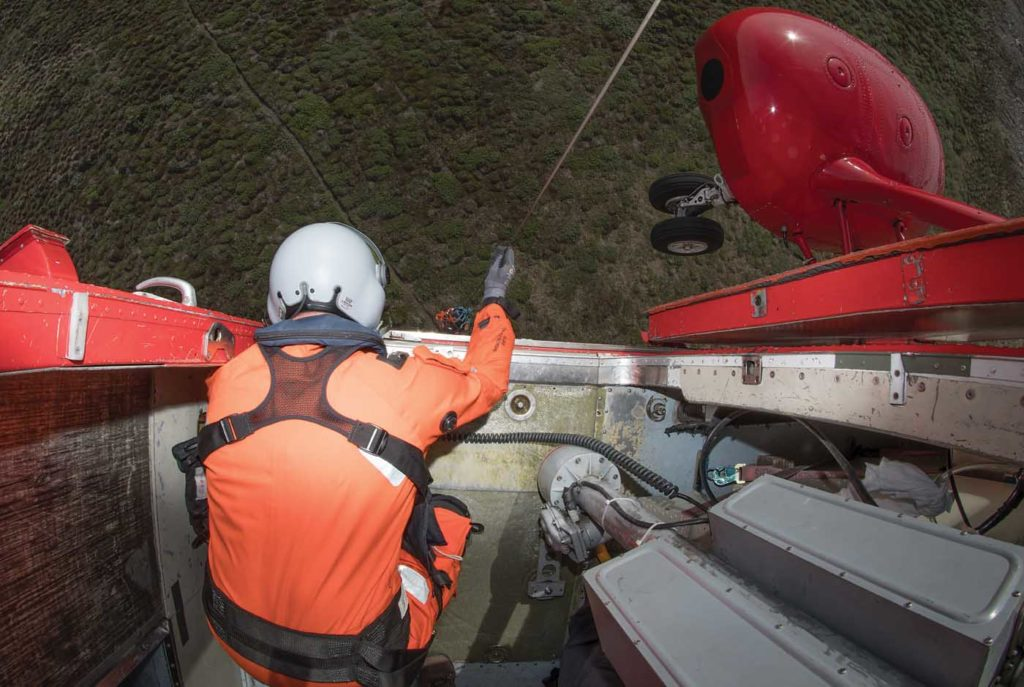 In addition to the pilots up front, a SAR crew includes a hoist operator and hoist assistant. Neil Dunridge Photo
