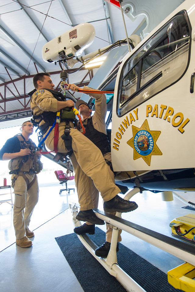 ARS instructor David Arias (left) looks on as officer Shaun Bouyea (on the hoist hook) and officer Brandon Hallam familiarize themselves with hoist hardware and procedures. Dan Megna Photo