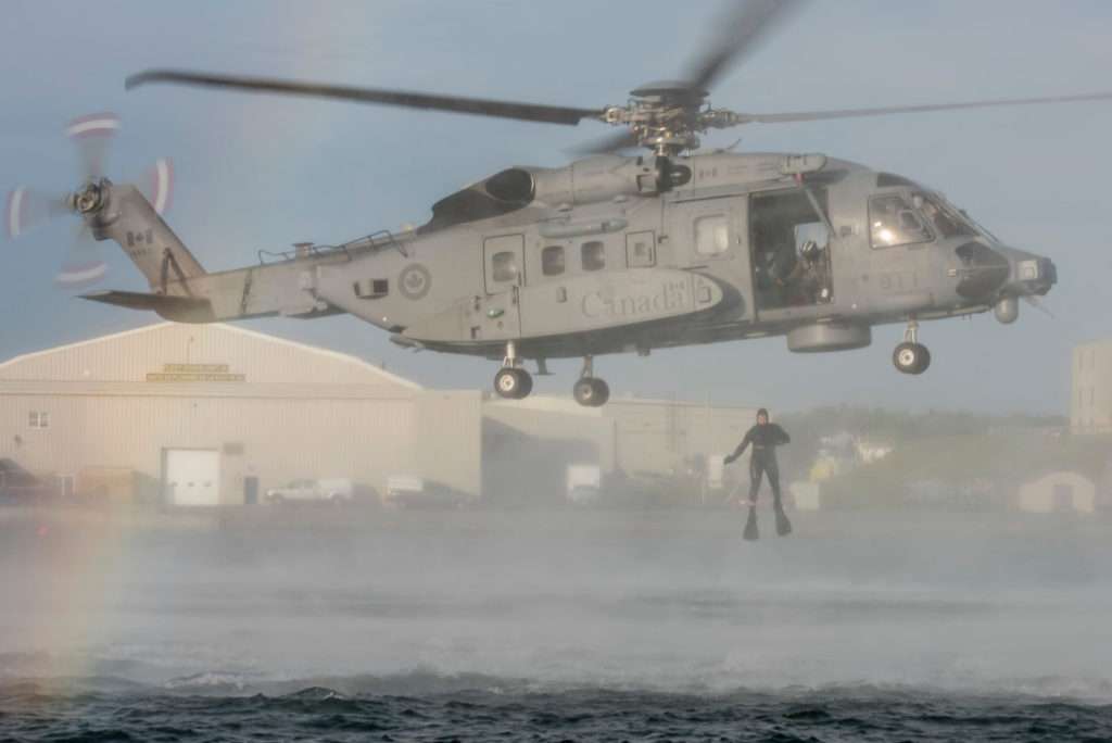 Helicopter Operational Test and Evaluation Facility, with assistance from with Fleet Diving Unit, conduct wet hoist training operations from a CH-148 Cyclone in and above the Halifax harbour. Cpl Anthony Laviolette Photo