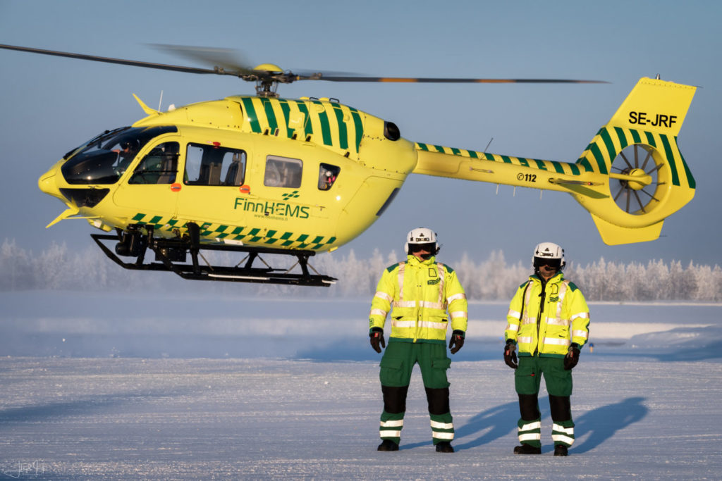 Two FinnHEMS paramedics demonstrate the gear necessary to work in the
