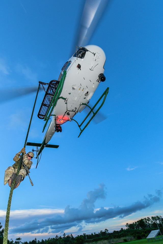 A member of the Seminole County Sheriff's Office SWAT team practices fast roping from the new H125.