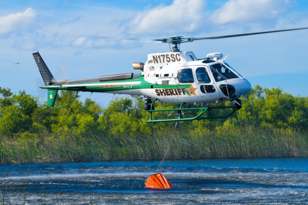 The Aviation Section's new H125 has a cargo hook equipped to sling a 210-gallon Bambi Bucket, which it uses to control brush fires around the county in hot and dry conditions. Mike Reyno Photo