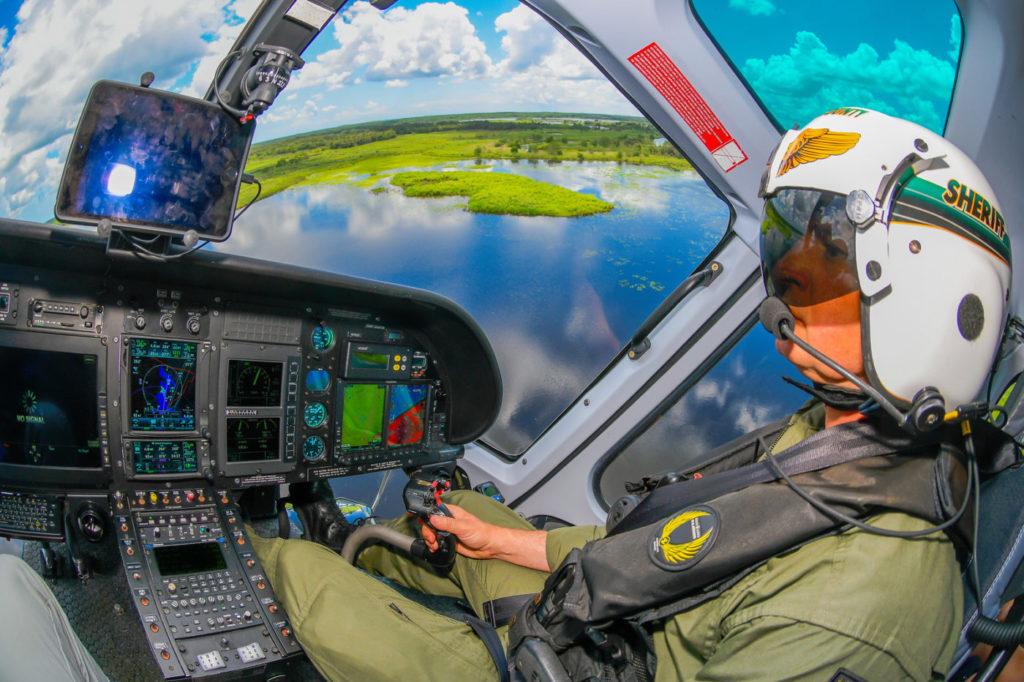With numerous waterways in Seminole County, the Aviation Section often receives calls to locate kayakers or boaters who have lost their way. Here, chief pilot Steve Farris flies the H125 above wetlands. Mike Reyno Photo