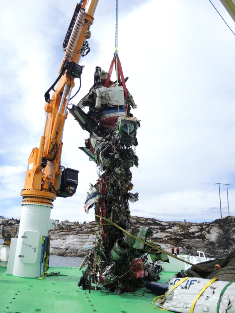The main wreckage of LN-OJF is recovered from the water. AIBN Photo