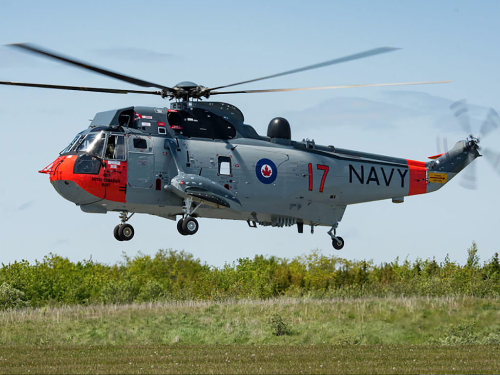 Sea King helicopter CH12417, painted in 1963 Royal Canadian Navy livery, hovers in Shearwater, Nova Scotia, in June 2018. Cpl Cody Chaisson Photo