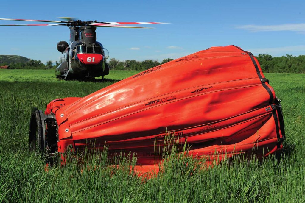 A key component of Billings' firefighting work is the Bambi Bucket, which the operator has had modified with faster pumps. Skip Robinson Photo