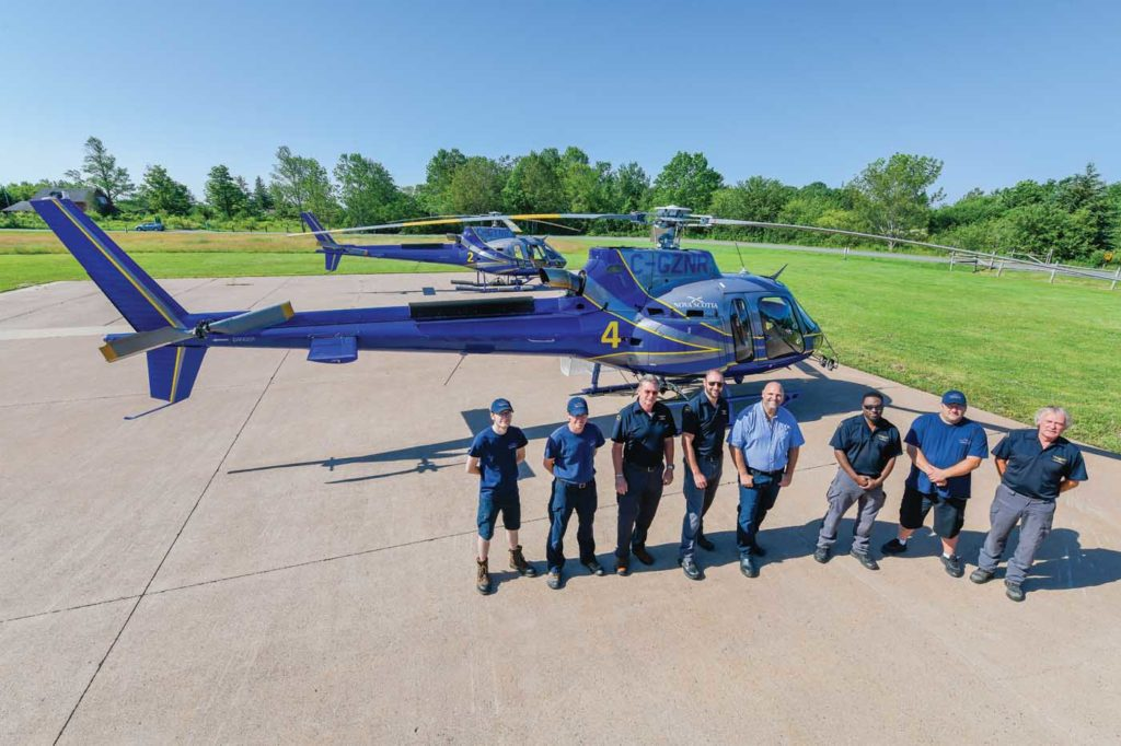 Aviation Services maintenance staff and pilots pose for a picture outside the department's hangar in central Nova Scotia. It has four full-time maintenance staff and six pilots. Mike Reyno Photo