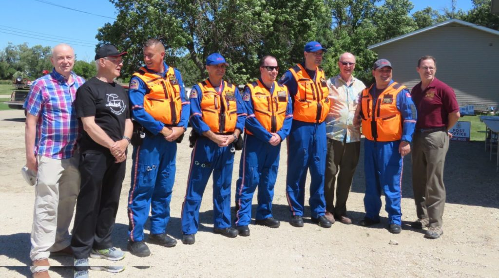 Homewood Reunion Committee members Frank Froebe (left), Gerry Suski and Charlie Froebe (right), along with CAHS Manitoba president Jim Bell stand with crewmembers from STARS Air Ambulance. Bill Zuk Photo