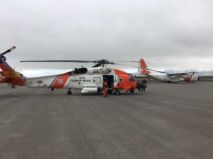 A Coast Guard Air Station Kodiak MH-60 Jayhawk aircrew swaps with another Jayhawk aircrew in Cold Bay, Alaska, to conduct a long-range medevac 190 miles west of Dutch Harbor, Alaska. An HC-130 Hercules aircrew assisted by providing a communications platform and transporting the extra Jayhawk aircrew. Lt. Jeff Mistrick Photo